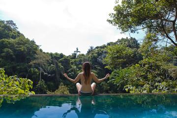 girl in the tropic jungle pool
