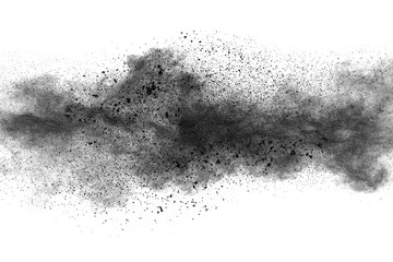 Black powder explosion against white background.Closeup of black dust particles explode isolated on white background. Fototapete