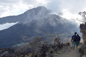 Mount Meru partly covered by clouds seen from the top of Little Meru, Arusha National Park, Tanzania