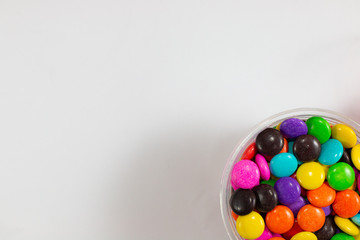 colorful sweet circle shape . sugar yummy balls candy in box on white background .
