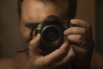 a man with a camera in the mirror