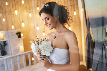 Happy and beautiful bride with bouquet of flowers