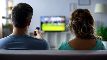 Man nervously switching channels, poor quality of digital smart tv connection