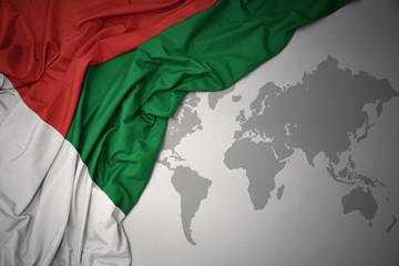 waving colorful national flag of madagascar .