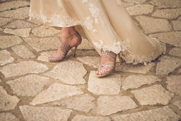 Bride in elegant pastel dress and shoes