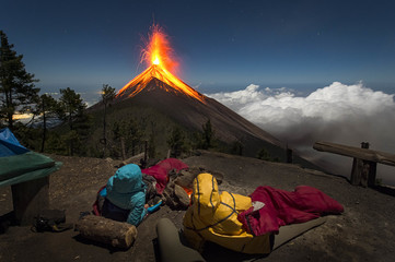 Young couple watching eruption of Fuego Volcano, Guatemala