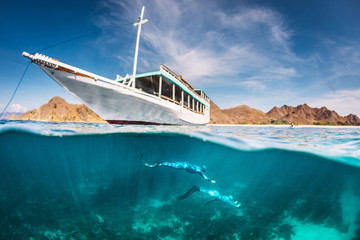 Boat and free divers underwater, Komodo, Nusa Tenggara Timur, Indonesia