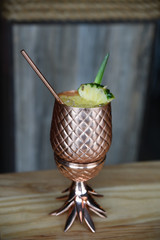 Tropical drink in pineapple shape copper cup