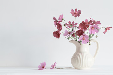 summer flowers in vase on white background