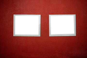 Empty picture frames on a red wall