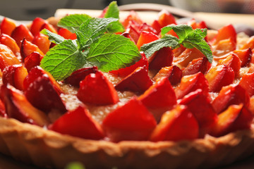 Delicious pie with plums, closeup