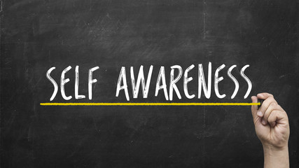 self awareness concept. Hand with yellow marker writing self awareness inscription text on chalkboard.