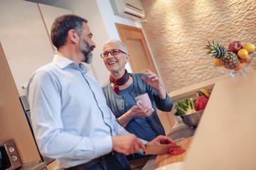 Senior couple having fun in home kitchen