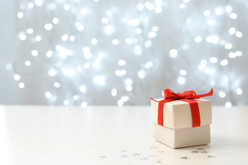 Christmas gift on table against blurred background