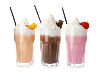 Keuken foto achterwand Milkshake Glasses with delicious milk shakes on white background