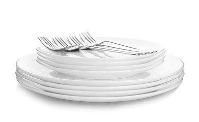 Stack of plates with forks on white background
