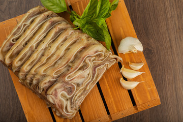 Home-made meat loaf on a wooden surface.