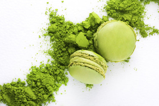 Macaroons with green tea powder matcha on white background