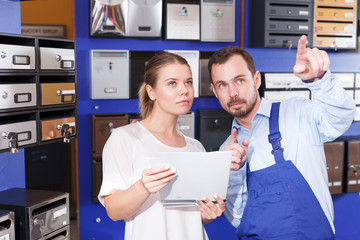 Girl consulting about mailbox with worker