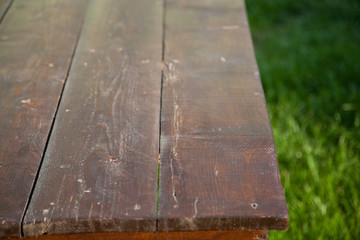 wooden picnic tabletop in the garden - summertime background with copy space