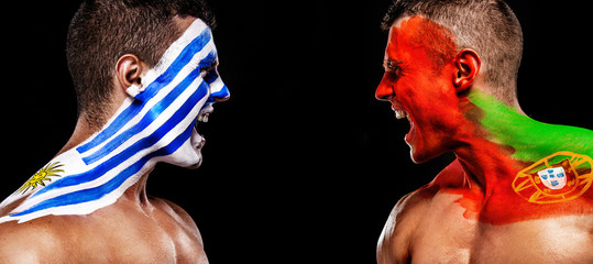 Soccer or football fan with bodyart on face with agression - flag of Uruguay vs Portugal.