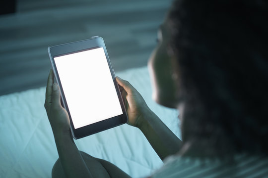 Woman Holding Tablet PC At Night Mockup