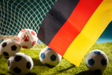 Flag of Germany. Football. Flag of Germany at the stadium. Football game. Germany national football team. Soccer ball in the stadium. Football pitch.