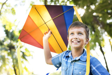 Boy playing with a colorful kite