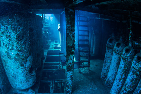 An underwater shot inside a room in the shipwreck of the Kittiwake that uses natural light as opposed to a strobe. The wreck has been sunk deliberately and is shallow enough to allow light penetration