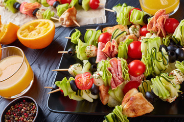 skewers with vegetables, meat and cheese