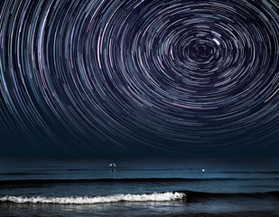 a star trail photography with Polaris over a sea