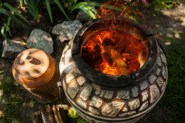 Portable tandoor with a burning fire. View from above