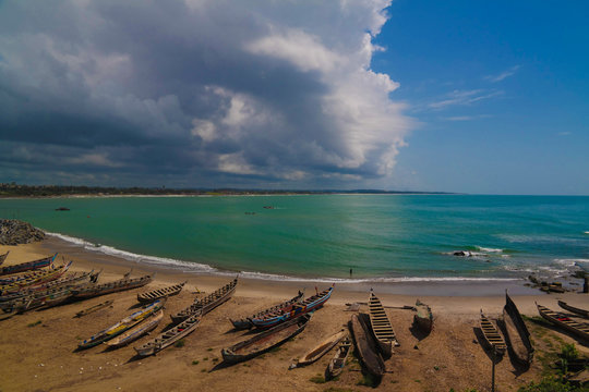 Landscape view to atlantic ocean and fishing boats from the roof of Elmina castle and fortress in Ghana