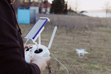 Man is piloting drone from smartphone
