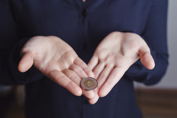 Woman's hands holding etherium coin