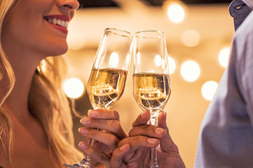 Couple toasting campagne flutes