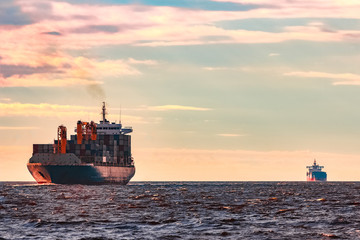 Blue container ship underway Wall mural