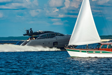 Grey motor yacht in move
