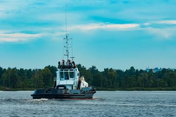 Black tug ship underway
