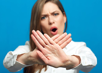 Screaming woman showing stop symbol.