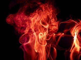 Red smoke on black background