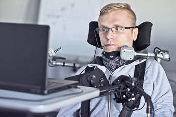 Disabled student in class room.