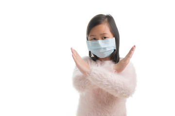 Asian kid girl age 7 years with protection mask against flu virus