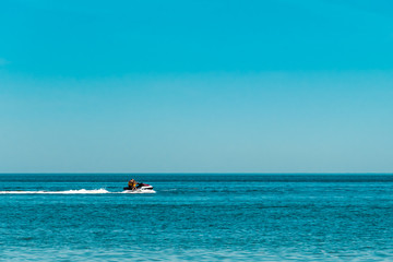 two people on a jet ski floating on the sea