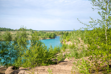 Photo of picturesque hilly terrain and blue lake