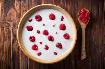 raspberry berries yoghurt  eating healthy food Wooden plate spoon Vintage background