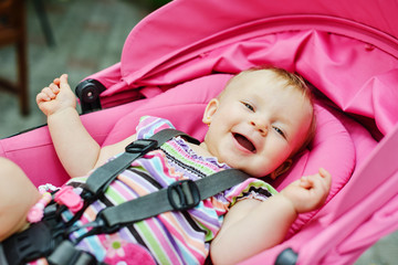 happy baby in the stroller