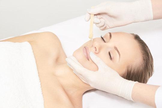 Sugar hair removal from woman body. Wax epilation spa procedure. Procedure beautician female. Mustache