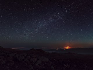 Scenic view of volcano against starry sky
