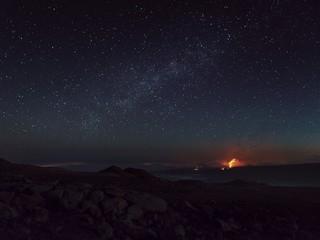 Volcano under night sky